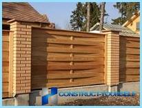 Statyba medinės tvoros piketas